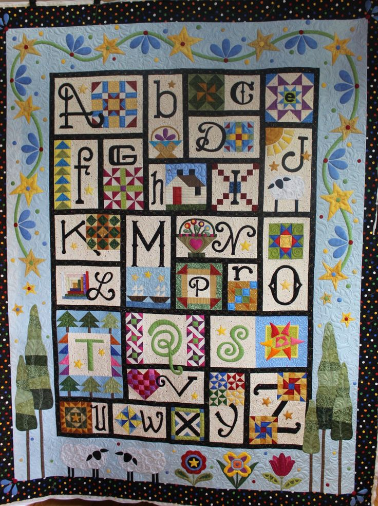 Quilted by Barbara Simons (SToneRidge Quilting), pieced by Karen Boe.