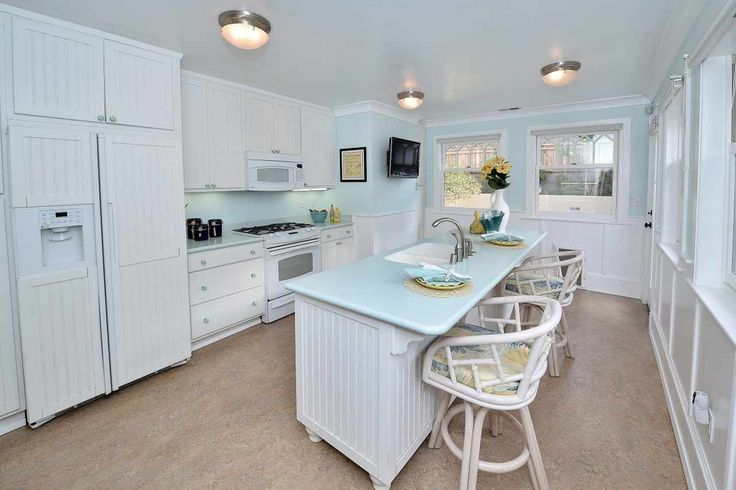 Cottage Kitchen with Concrete floors, Wainscoting, flush light, Crown molding, Built-in bookshelf