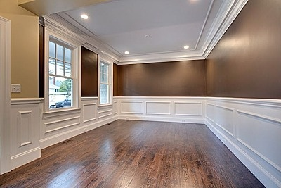 Wainscoting, crown molding and large trim moldings give this dining room an elegant look