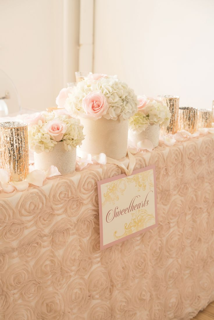 Blush and gold centerpieces, wedding linens and decor. Head table, sweetheart table by @mwsandevents Photography by AMC Studios