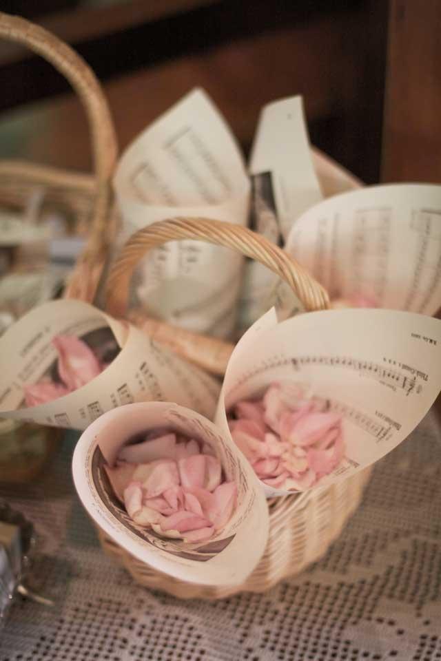 Rose petal wedding confetti in vintage sheet music cones