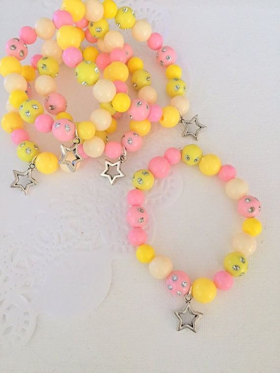 Star bracelet, star kids birthday party, party favor beaded bracelet, kids jewelry, childrens jewellery. yellow, pink, SET of TEN.  ****************************** Party planning is already so stressful. Leave the favors up to us!  This listing is for (10) child sized bracelets.  DETAILS and MEASUREMENTS: Beads vary in sizes from 6mm-10mm. The length of a bracelet is 6.5 (we can make them smaller or bigger for you).  COLOUR & CHARM CHOICES: If the bracelet does not match your party theme e...