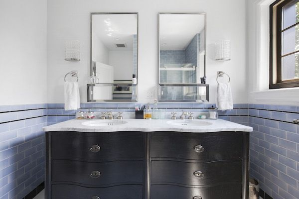 A traditional Restoration Hardware black vanity topped with marble fits perfectly in this classic, elegant bath.