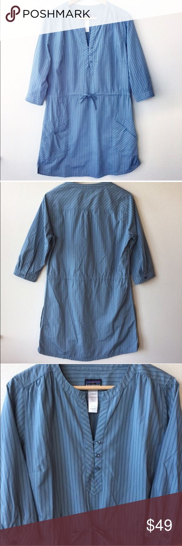 """Patagonia Shirt Dress with Drawstring Striped 10 Patagonia Shirt Dress. Size 10. Retail: $89. Blue background with triplets of white pin stripes. Cinched drawstring waist. V-neck. 3/4 length sleeves with button closure. A-line skirt. 3 buttons on chest. On-seam patch pockets on hips. Darts on bust for flattering fit. Shirttail hem with 1.5"""" slits. Fabric: 57% Polyester, 43% Nylon.  💎New without tag condition! No flaws. 🔹Length: 36.5""""  🔹Bust: 38"""". 🔹Waist: 34-36"""".  🛍15% Off Bundles of 2…"""