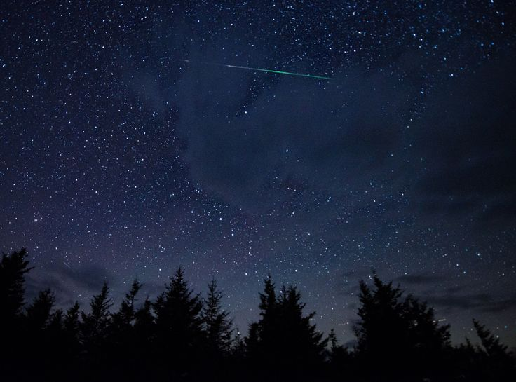 in this 20 second exposure a meteor streaks across the sky during the annual perseid meteor shower thursday aug in spruce knob west virginia