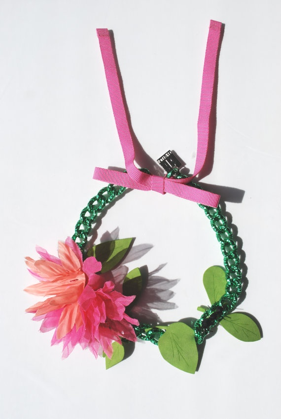 Painted metal chain choker knotted with a thin grosgrain ribbon.  A leaf and flower branch made of various fabrics closes up a small black crystal jewellery ant.  #jewels