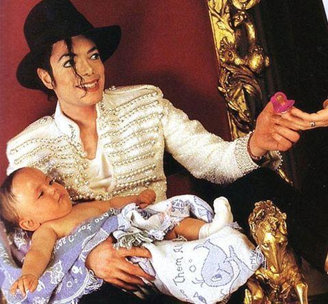 Michael Jackson holding his son, Prince