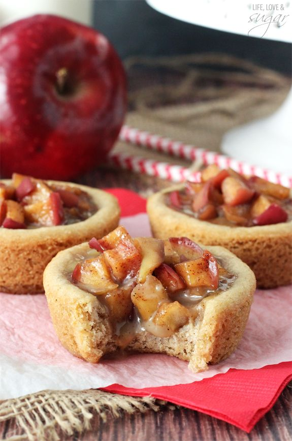 These Caramel Apple Cookie Cups are my first real taste of fall! A brown sugar cookie cup is filled with caramel, then topped with cinnamon apples and it is SO good!