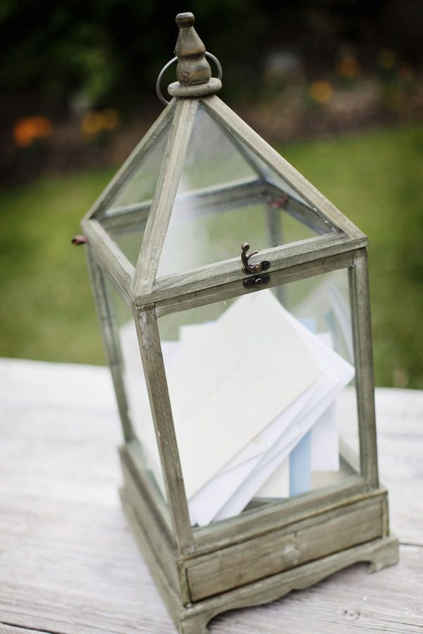 Place a lantern at the welcome table for the guests' cards. Source: style me pretty #lantern #cardbox
