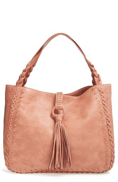 Braided, woven and tassel detailing lends an artisanal look to a super-spacious tote fashioned from faux leather.