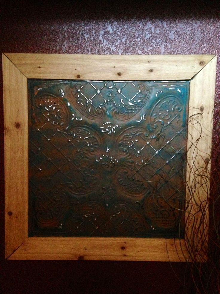 Old tin ceiling tile painted and distressed