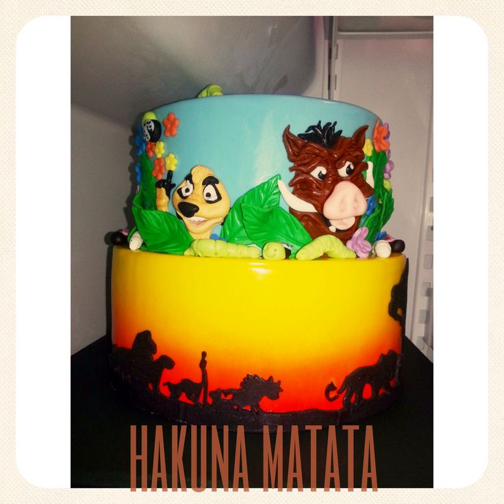 The Lion King themed birthday cake airbrushed bottom tier wrapped in a ...