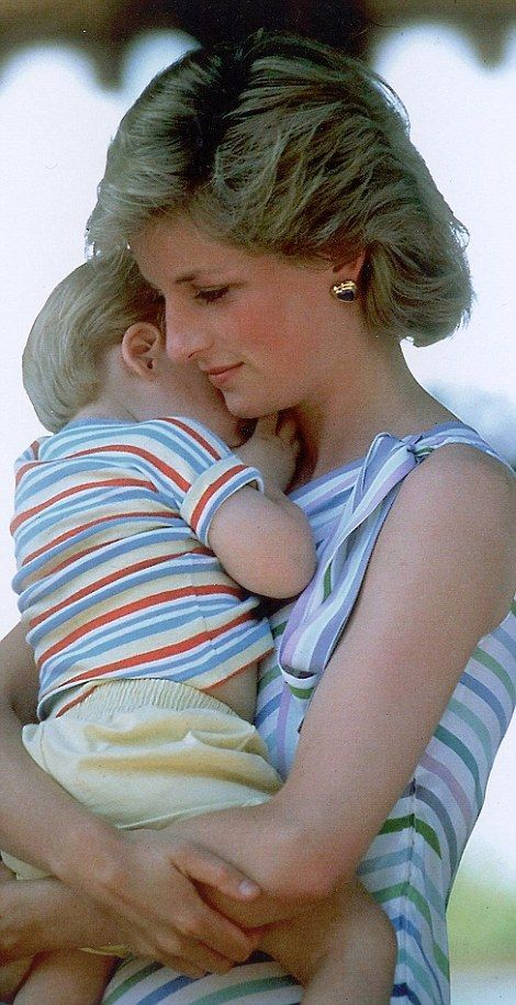 Mother love: A hug for two-year-old Harry from Diana during a family holiday in Majorca in 1986