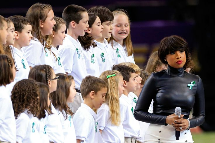 NEW ORLEANS, LA - FEBRUARY 03: Singer Jennifer Hudson performs 'America The Beautiful' with the Sandy Hook Elementary School Chorus prior to the start of Super Bowl XLVII between the San Francisco 49ers and the Baltimore Ravens at the Mercedes-Benz Superdome on February 3, 2013 in New Orleans, Louisiana. (Photo by Jamie Squire/Getty Images)