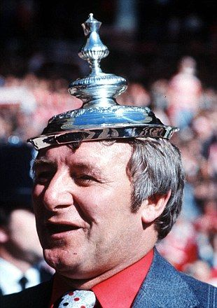 Hat trick: United boss Tommy Docherty celebrates the 2-1 1977 FA Cup win over Liverpool