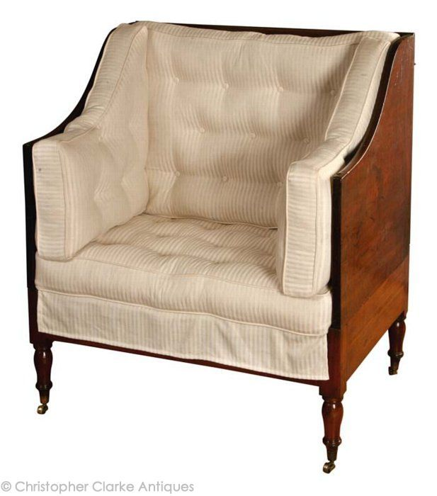 Campaign Furniture, English, 1810. The Tent Chair has a 3 section pine frame seat which folds out to extend its length for use as a bed. For travel, the 2 bolts that join the back board to the sides are removed and they fold on their hinges to lay on top of the seat. The sides will also lift off at their hinges. The back has 2 mahogany bars that twist vertically to add support to the back board. (photo 1)