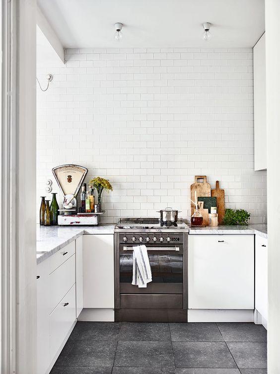 cute little white kitchen with grey floor