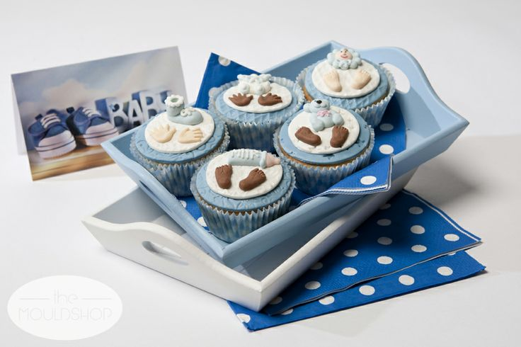 Cupcakes for a baby boy decorated with fondant using texture sheets and moulds