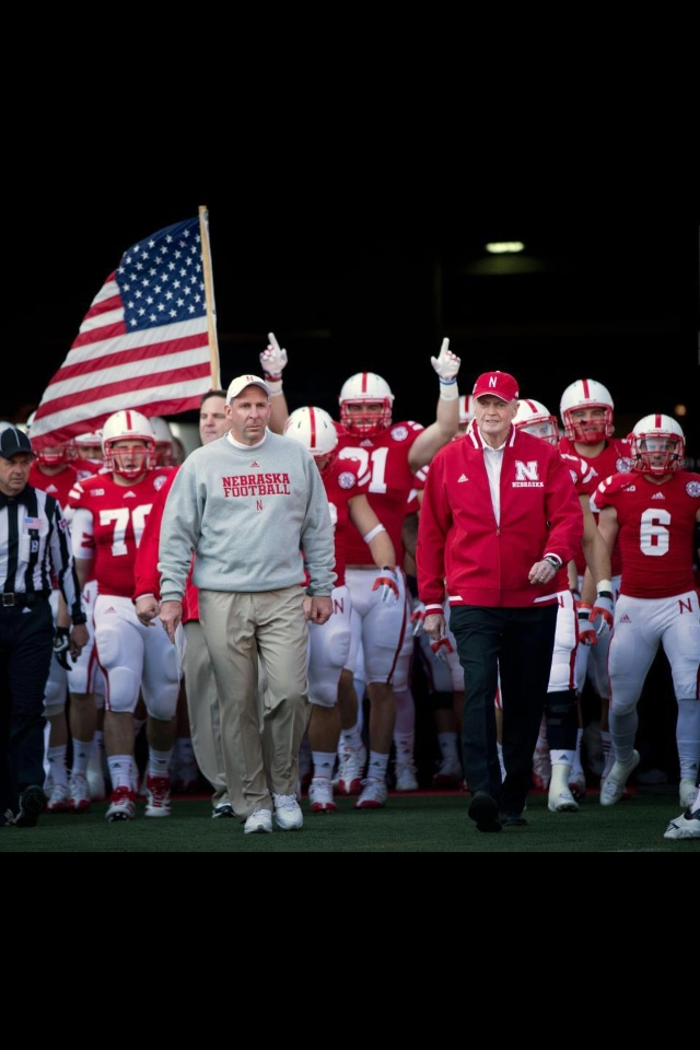 Coach Tom's last tunnel walk. A Nebraska Icon, We love you Tom, Thanks for the memories.
