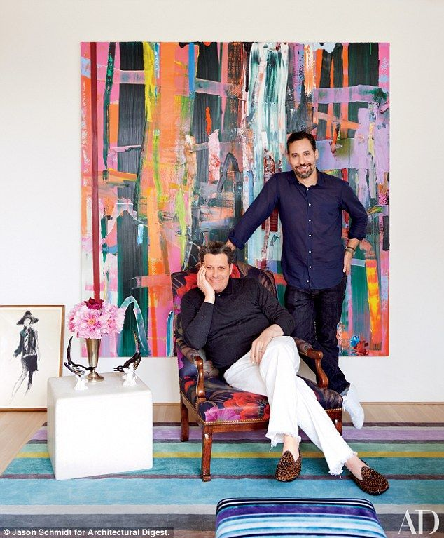 Behind the scenes! Designer Isaac Mizrahi (seated) and his husband Arnold Germer in their ...