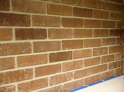This person had a white fireplace and she repainted it to be brick again. Looks like a satisfying project :)