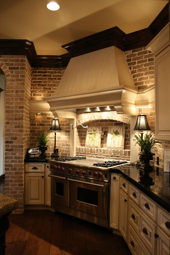 Gorgeous Kitchen with Brick, Wood Floors, and Painted Cabinets