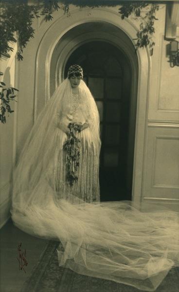 Wedding Dress, 1928, embroidered silk and lace. Ivory silk satin drop waist wedding dress has three skirt layers, American.