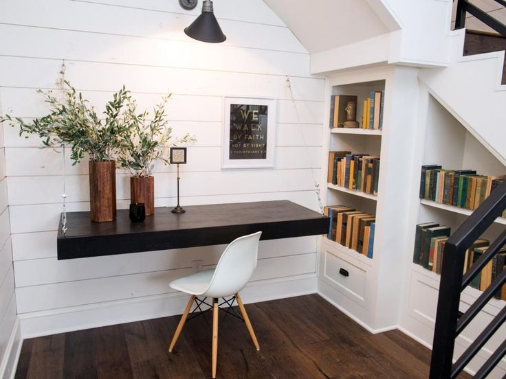 The office nook includes a custom-made floating desk and built-in bookshelves.