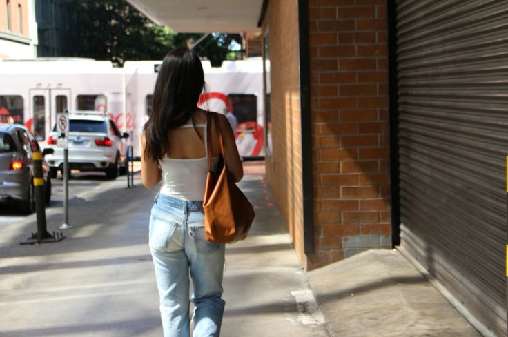 DIY distressed boyfriend jeans styled with TOPSHOP bodysuit. DIY how to on the blog www.thatsewcute.com