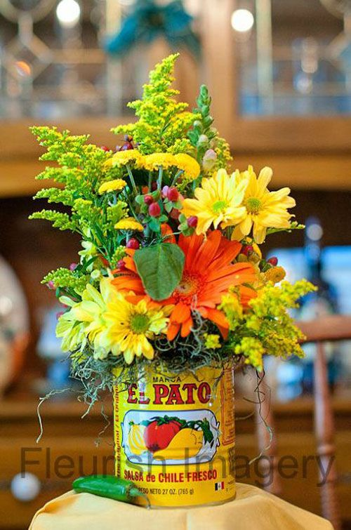 Mexican wedding centerpiece, El Pato tins. See more on WomanGettingMarried.com