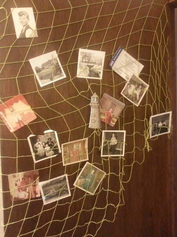 Hawaain themed birthday party: string up fishnet on the door and then put old pictures in the netting.