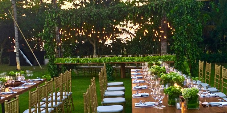 Wedding dinner setup with teak stained tables, Gold tiffany chairs, table top industrial lights. Bali Ultimate Wedding Furniture Rental #Bali