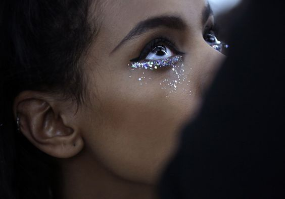 Under eye sparks.  I love how the rest of her makeup is so simple and then under her eye she has a line of sparkles that cascade down her face.: