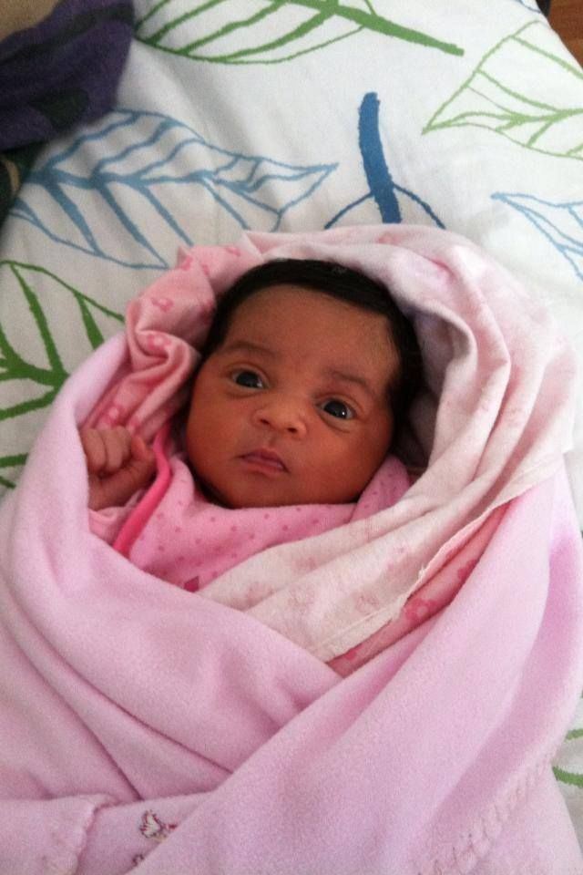 sweet cute beautiful black baby girl in pink clothes