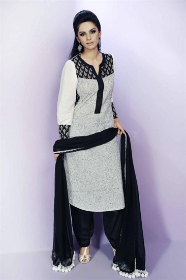 Black and white embroidered cotton kameez with plain black shalwar. The kameez has  black print lining and embroidery. The sleeves are plain white cotton with a black and white print cuff.  The dupatta is plain black with off white resham baubles on the edgeing.  £39.99