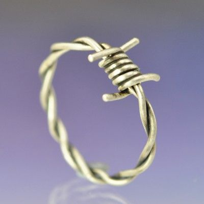 I don't the the barb wire look, but the twisty ring part is cool :)