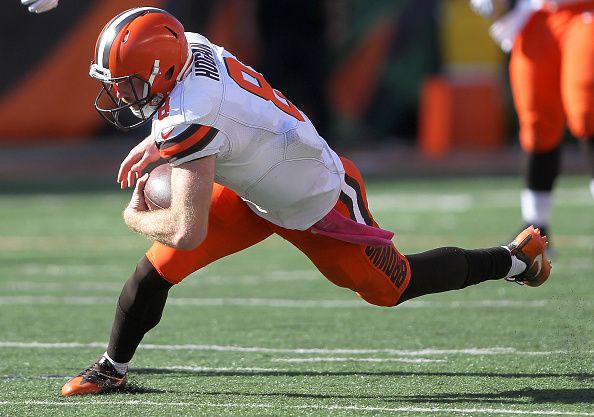 Browns vs. Bengals:     October 23, 2016  -  31-17, Bengals  -       Kevin Hogan #8 of the Cleveland Browns gets tripped up while carrying the ball during the third quarter of the game against the Cincinnati Bengals at Paul Brown Stadium on October 23, 2016 in Cincinnati, Ohio. (Photo by John Grieshop/Getty Images)