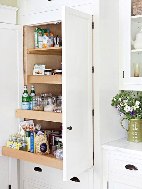 Swap out a few fixed shelves for pullout units that provide easy access to all things stored inside and avoid the jostling around of items w...