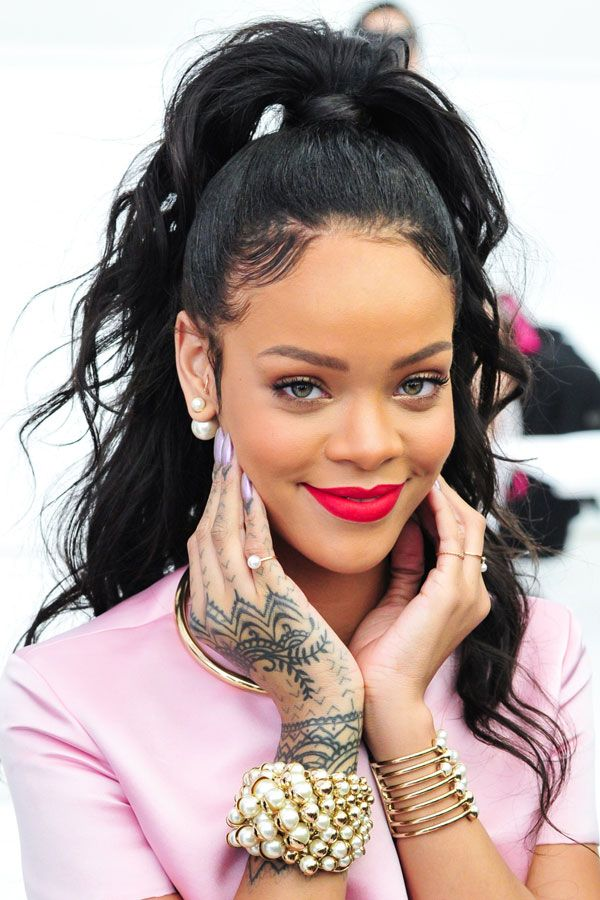 12 Reasons To Give Your Ponytail An Upgrade #refinery29  http://www.refinery29.com/celebrity-ponytail-pictures#slide6  Think high ponytails with lots o' curls are lame? Allow us to present Rihanna, who blows that theory right out of the water.