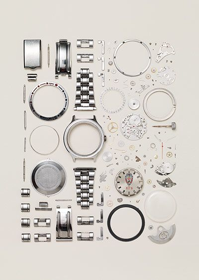Disassembled Russian Vostok watch from the 90s. Number of parts: 130 - Todd McLellan