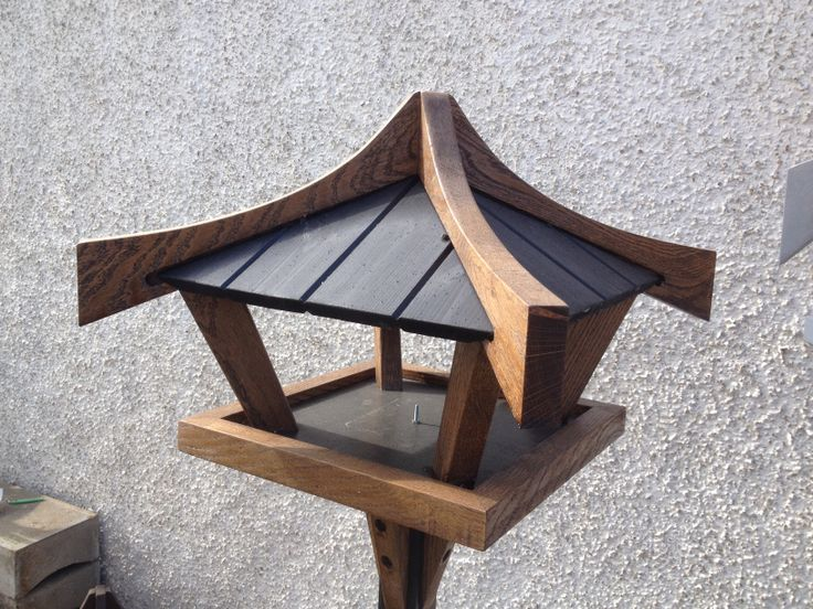 Solid oak framed bird table.