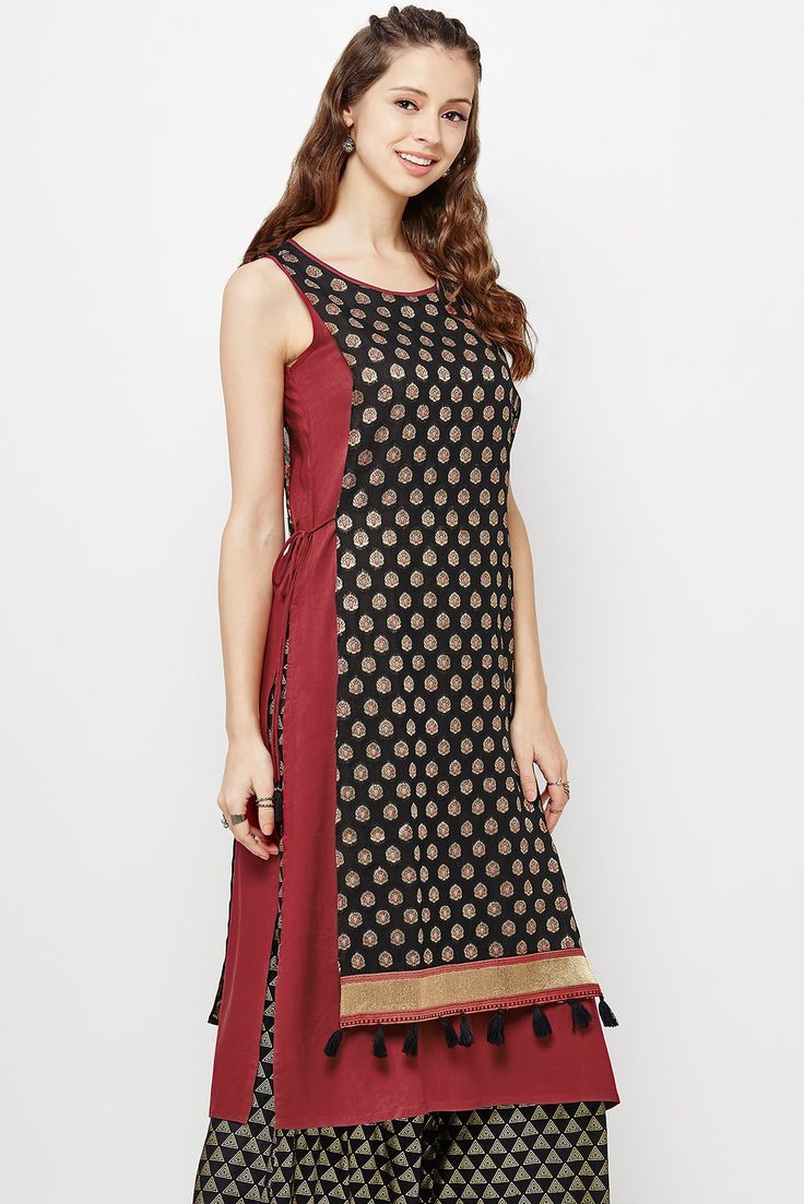 Sleeveless round neck tabard style kurta with a Jacquard upper layer and a solid Rayon Moss inner layer. It showcases tassels around the hemline and drawstring tie-up on either sides.