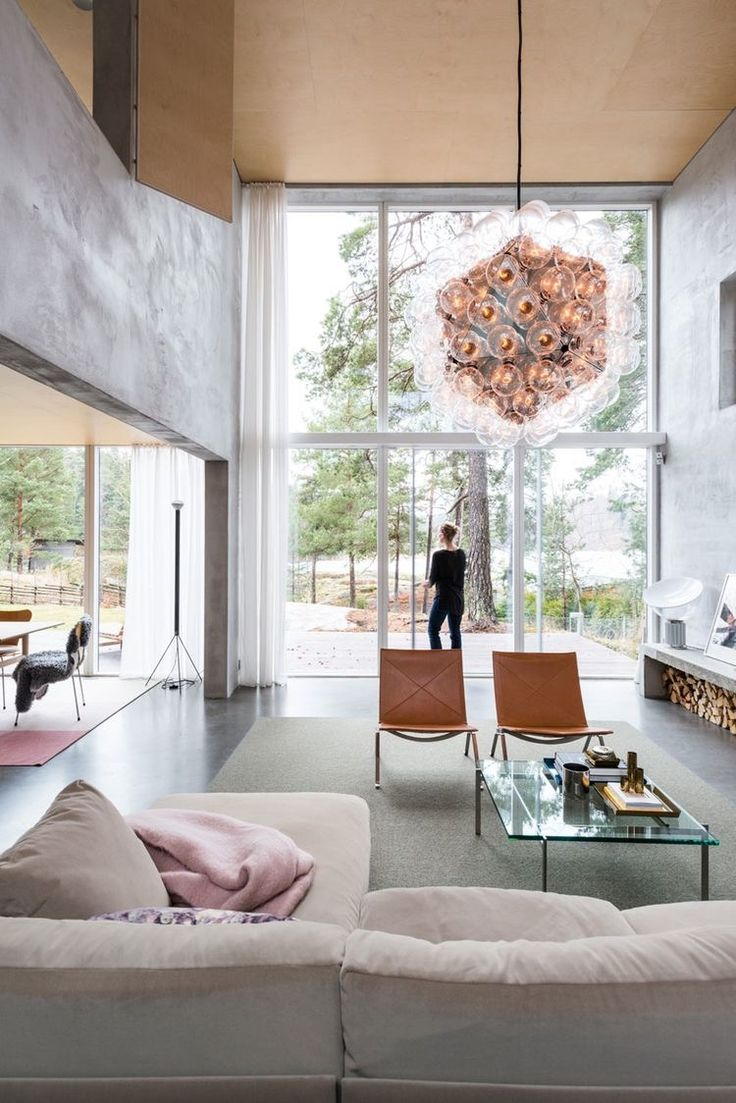 Love high ceiling and windows- as well as concrete - and lots of light