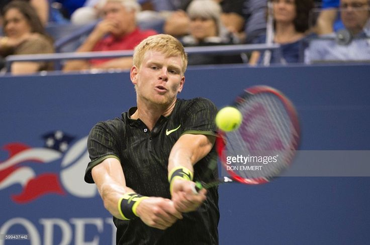 Kyle Edmund of Great Britain hits a return to Novak Djokovic of Serbia during…