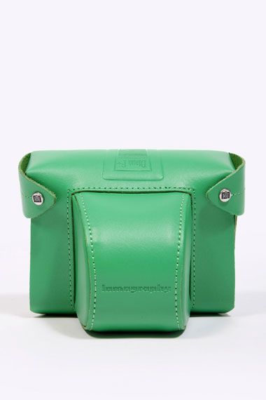 I want this camera case. Love the green!