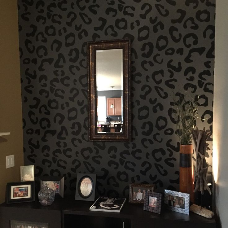An accent wall using our leopard print wall decals. Shown here in black.