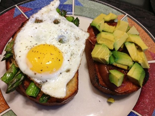Fried egg, asparagus, avocado, and charred tomato open face sandwich A yummy, vegetarian friendly meal that you can have for breakfast, lunch, or dinner!