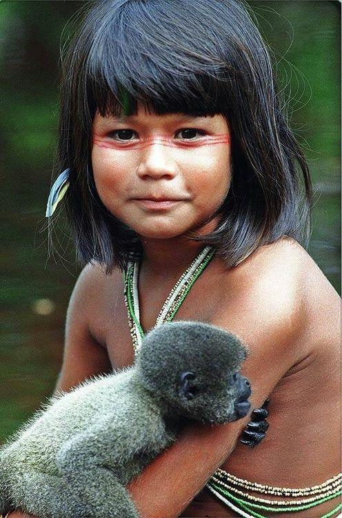An Amazonian girl in Ecuador with a monkey.