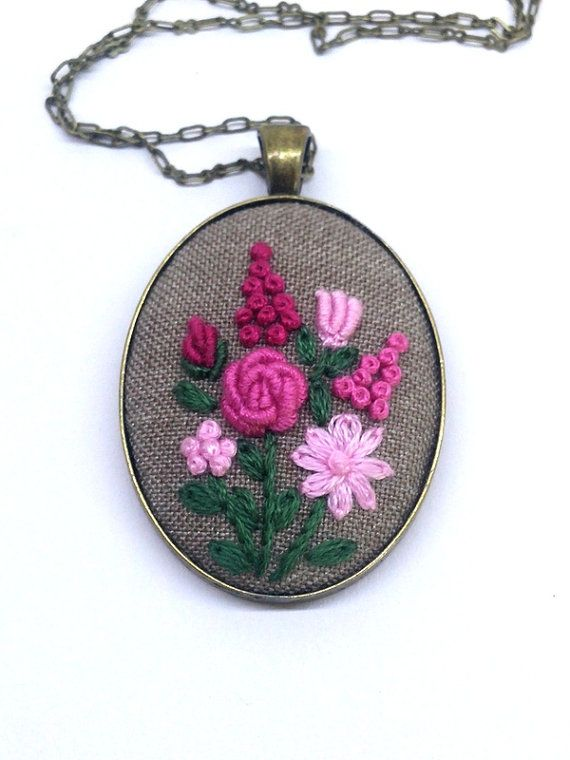 Hand embroidered pink flower bouquet on a cream fabric with color cotton embroidery thread and put into vintage bronze style cameo base. This bohemian necklace will be a lovely addition to any outfit. It will make you feel special whatever you were. • Pendant is 30x40mm (1.18x1.5) You can choose your desired necklace length from the drop-down menu. Leave a note at checkout for any custom length. Antiqued brass cable chain is closed with a lobster clasp (lead and nickel free). My pictures…