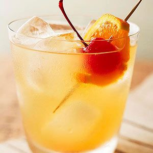 Whiskey Sour Dress up your cocktails with a fruit skewer. Try a maraschino cherry and an orange slice in this bourbon and citrus juice combination.